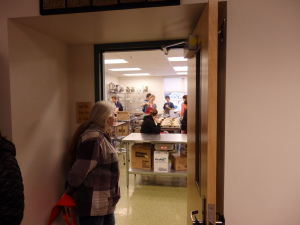 Customer Terry Wing waits outside of the culinary arts classroom to pick up her lunch.