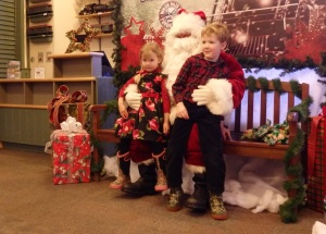 River and Isaac Powell from Whitehorse sit on Santa's lap.