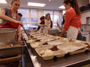 Students make lunches for more than 100 customers almost every Thursday.