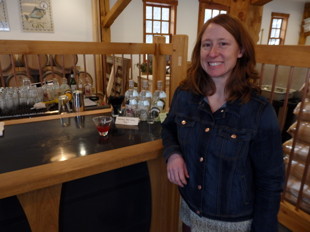Port Chilkoot Distillery owner and distiller Heather Shade stands at the bar of the tasting room.