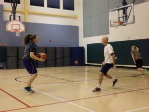 Coach Greg Brittenham runs a drill at a recent girls' basketball practice.