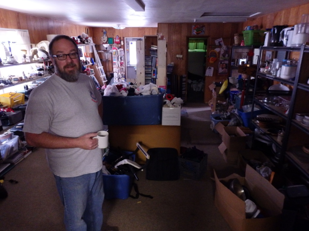 Salvation Army corps officer Dave Kyle stands in a room where he lets people sleep if they're in need of temporary shelter.
