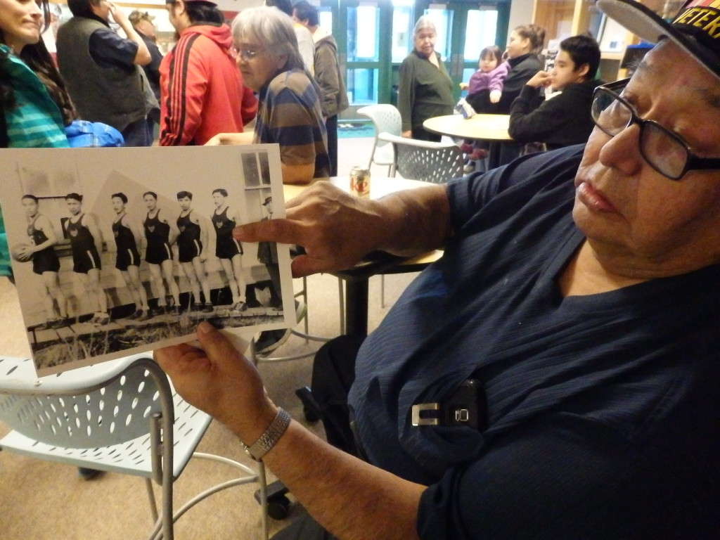 Charles Williams displays a picture from the 1940's of the Haines ANB team.