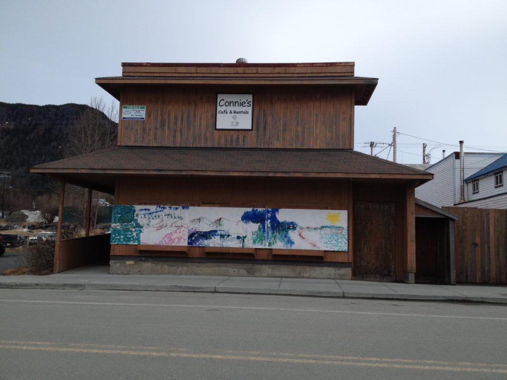 Local artist puts 'guerrilla art' on boarded-up Main St. building