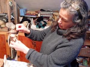 Debi Knight Kennedy holds pieces of her found object sculpture.