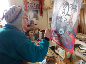 Donna Catotti painting Tlingit regalia for the Fort Seward art project.
