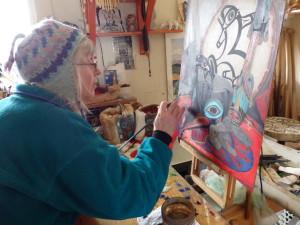 Donna Catotti painting Tlingit regalia for the Fort Seward art project.