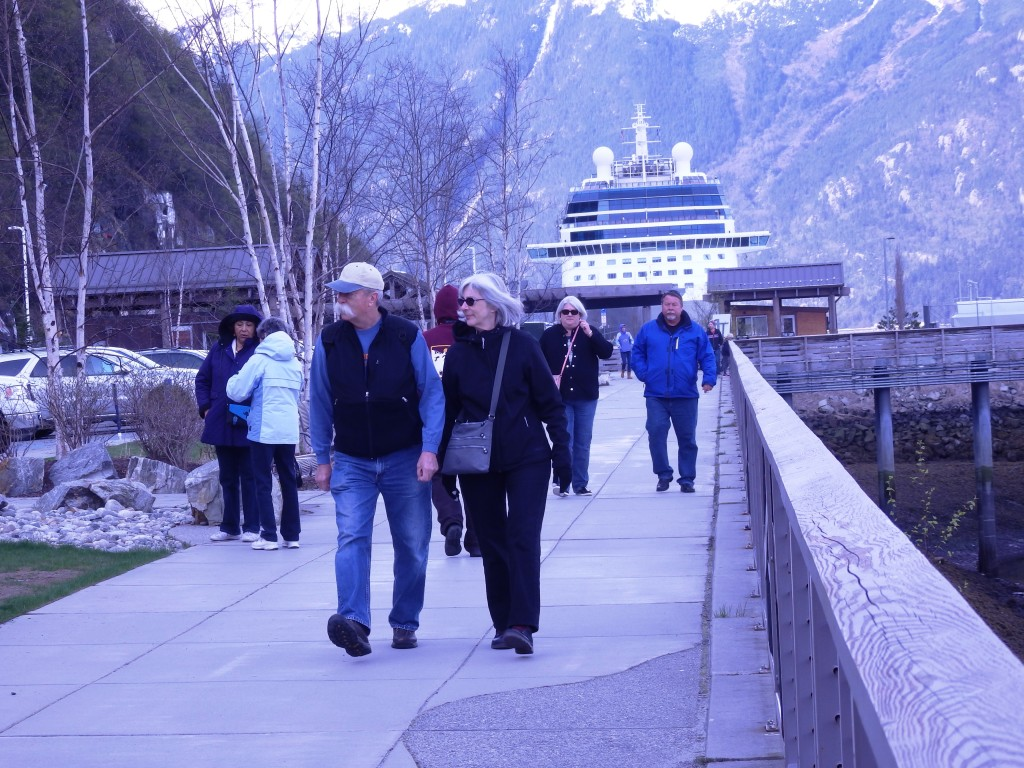 Tourists walk from the Celebrity Solstice towards town. (Emily Files)