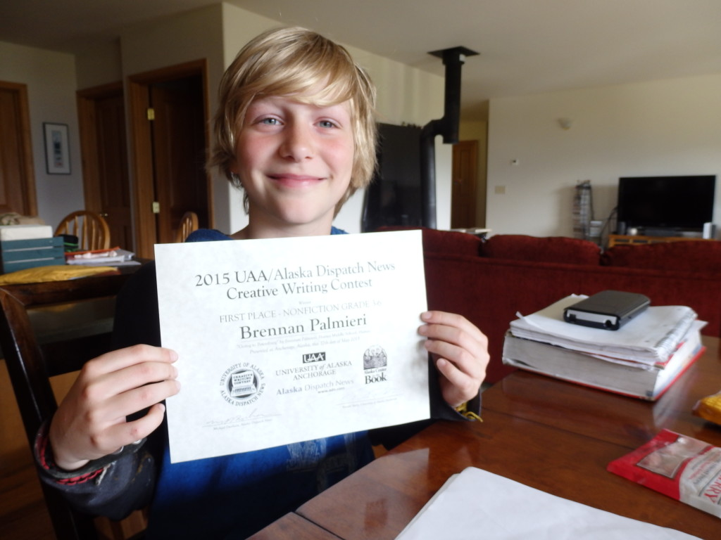 Brennan Palmieri with his certificate from the writing contest.