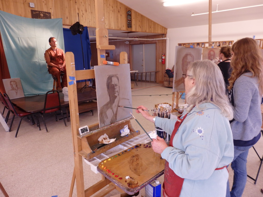 Haines artist Donna Catotti paints Tim Ackerman with the other workshop participants. (Emily Files)