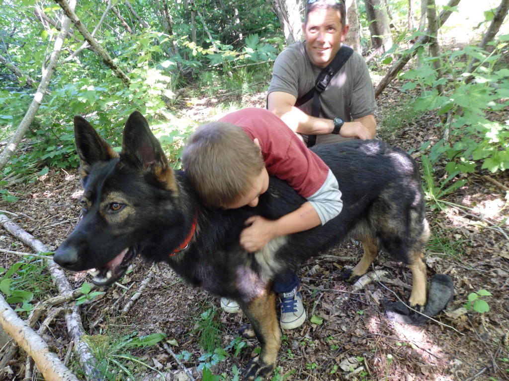 Hayden Jimenez hugs Hera after she finds him and his dad in the woods during a training. (Emily Files)