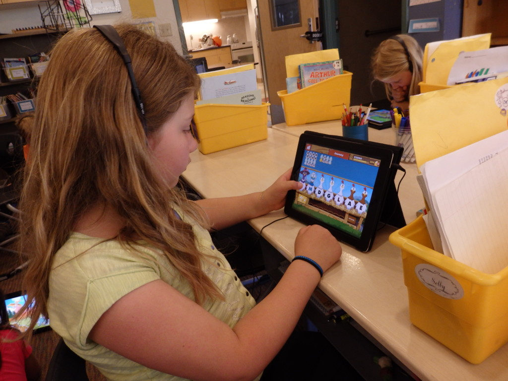 Second grader Selby Long uses a spelling app on a school iPad. (Emily Files)