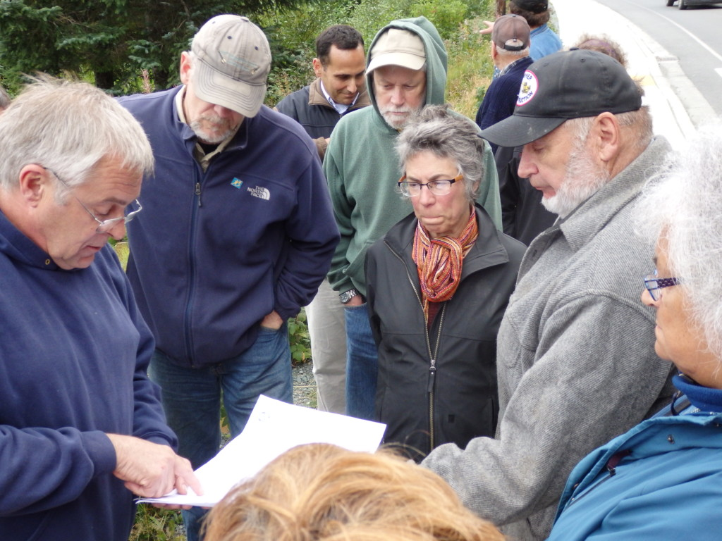 Brian Lemcke, Burl Sheldon, Debra Schnabel and Don Turner look at the 95 percent design for the small boat harbor expansion. (Emily Files)
