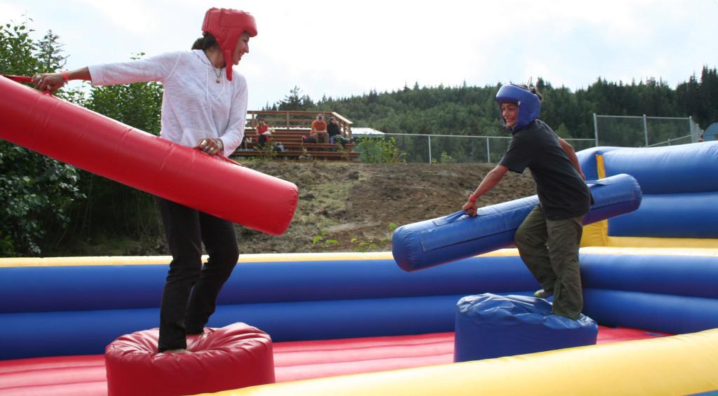 Fair-goers compete in bouncy game. (Greta Mart)