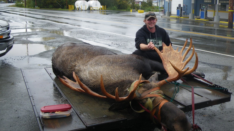 Hunter Marty Smith with his 61-and-a-quarter-inch moose. (Courtesy AlaskaFish and Game)