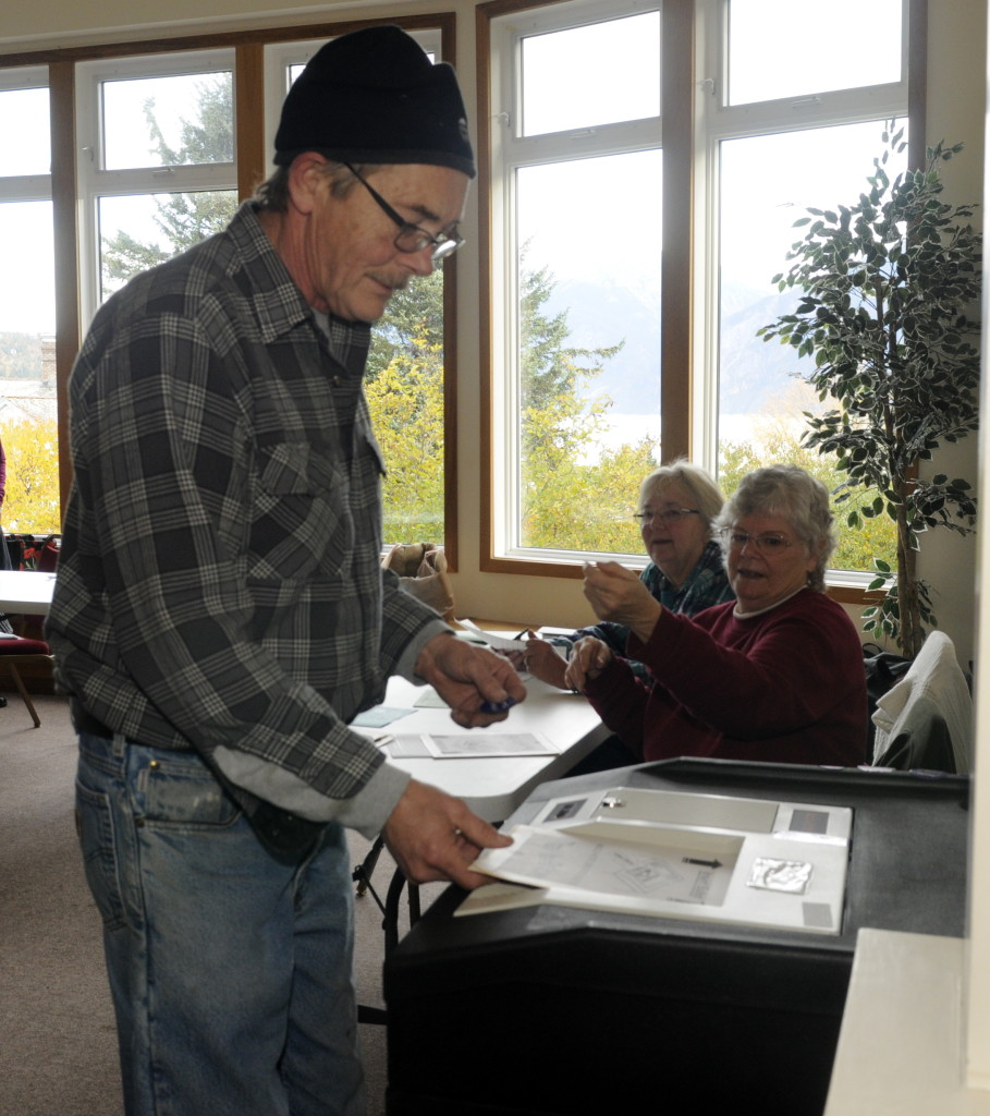 Borough assembly candidate Jerry Lapp casts his votes on Tuesday. Lapp is currently tied with Tresham Gregg for the second seat. (Jillian Rogers)