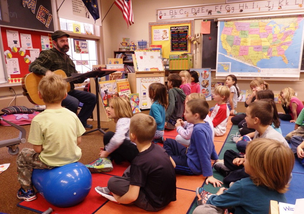 Music teacher James Baldwin sings with first and second graders. (Emily Files)