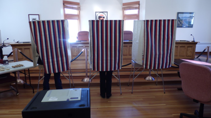 Skagway residents cast votes in the 2015 municipal election. (Emily Files)