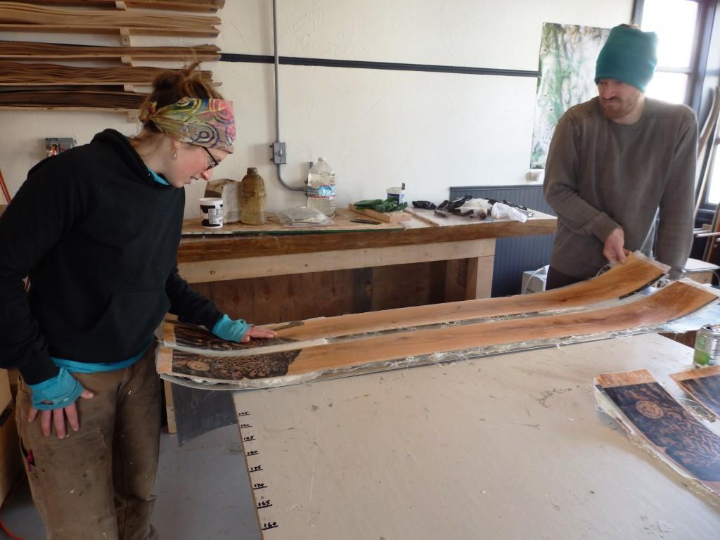 Lindsay Johnson and Graham Kraft examine a newly pressed pair of skis. (Emily Files)