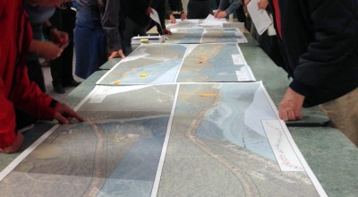 Haines residents look at a map of the Haines Highway at a project information meeting in 2015. (Jillian Rogers)