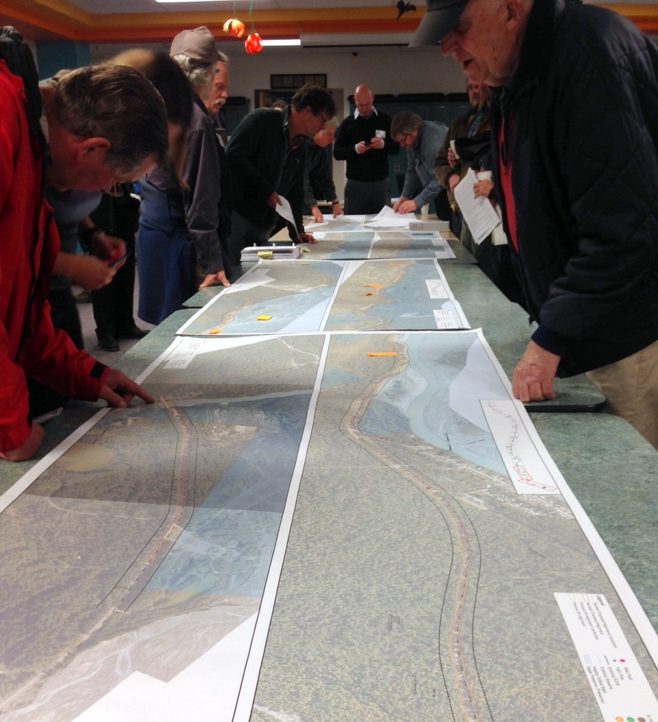 Haines residents look at a map of the Haines Highway at a workshop Wednesday evening. (Jillian Rogers)