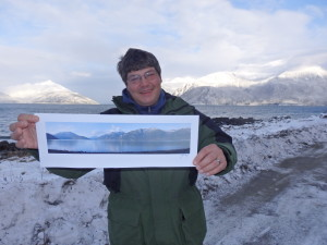 John Hagen with a print of his photograph that will be blown up and displayed at Port Chilkoot dock. (Emily Files)