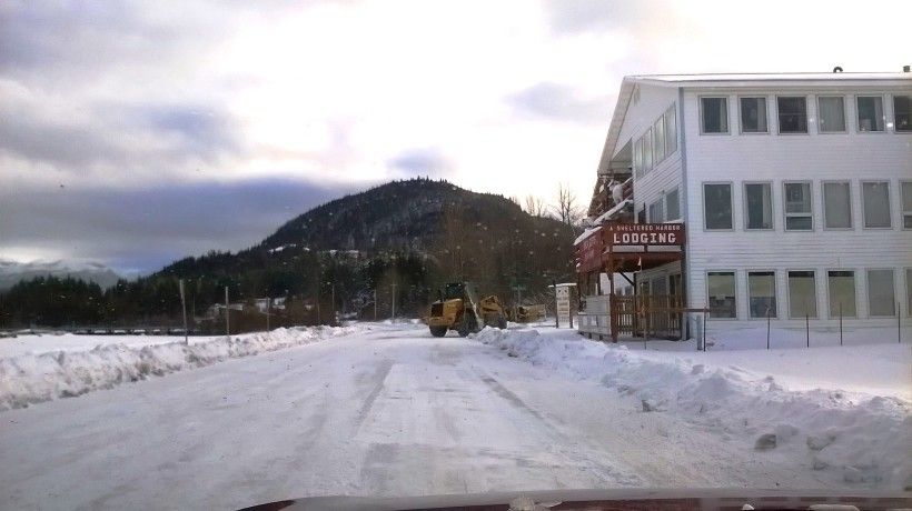 A plow turns off the highway in Haines Tuesday. (Emily Files)