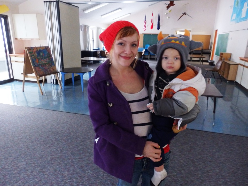 Sarah Marquardt with her son Odin in an empty Mosquito Lake School classroom. (Emily Files)