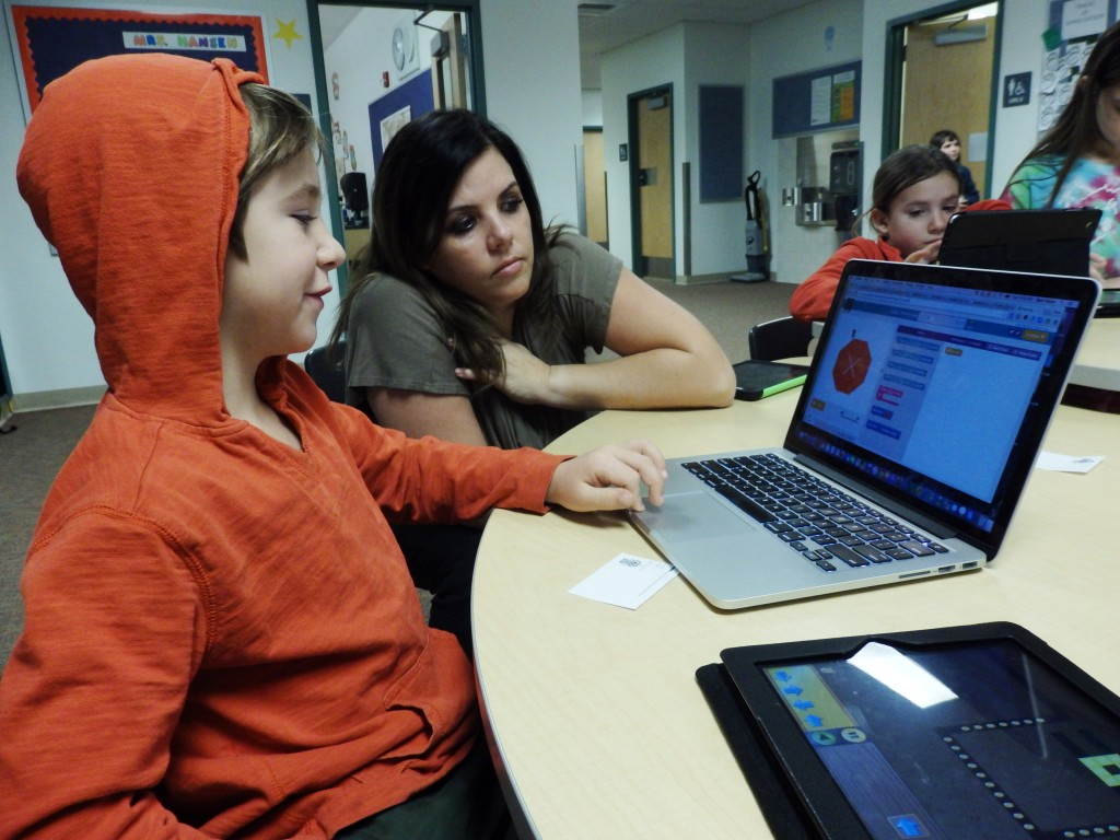 Second grader Nolan Wald learns coding with technology coordinator Sara Hadad. (Emily Files)