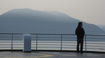 A passenger on the deck of an Alaska Marine Highway ferry. (Flickr Creative Commons - supafly)