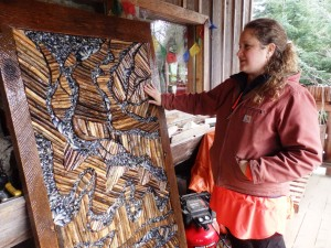 Megan Morehouse with her mosaic for the Fort Seward Outdoor Art Project. (Emily Files)