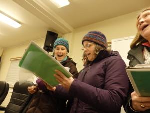 Women's choir members serenade Neussl with a song about ferries. (Jillian Rogers)