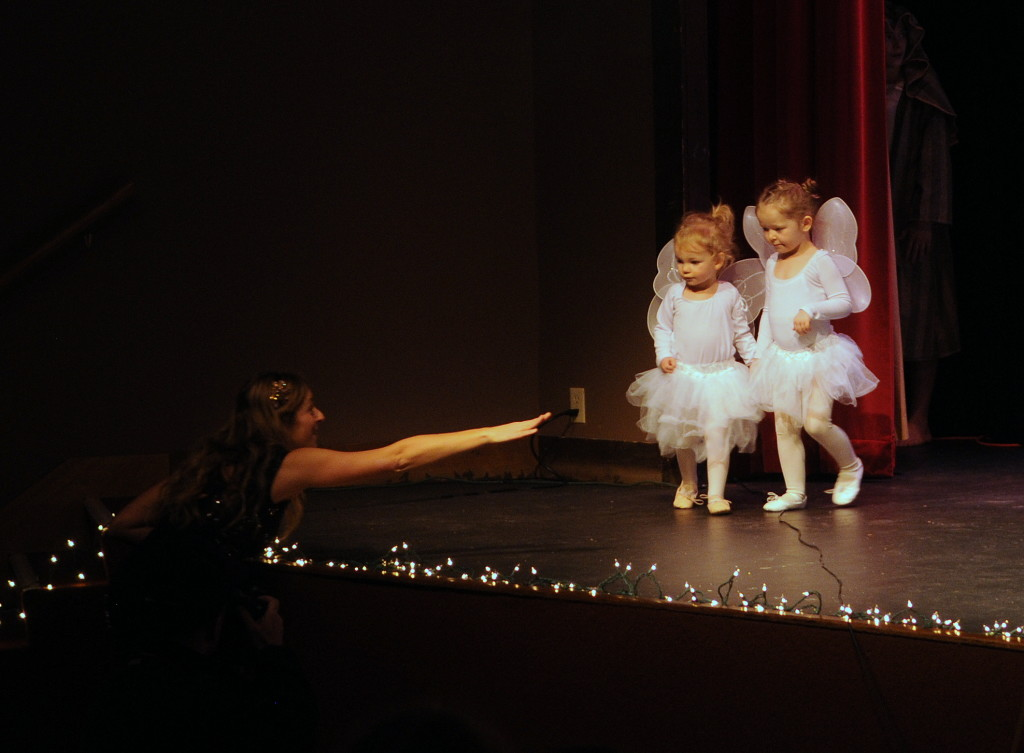 Preschooler angels are directed to the other side of the stage. (Jillian Rogers)