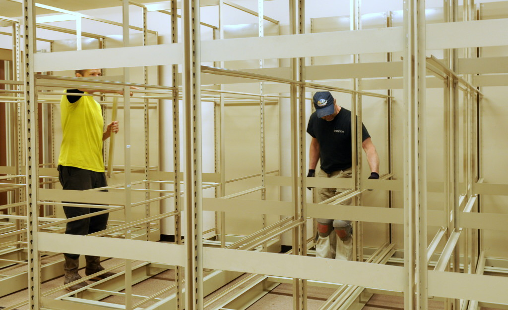 Dawson Construction employees assemble a maze of framing on Monday at the Sheldon Museum. (Jillian Rogers)