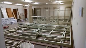 Piles of shelf parts waiting to be assembled. (Helen Alten)