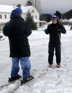 Instructor Thomas Hall helps Roger Kley learn how to ski. (Jillian Rogers)