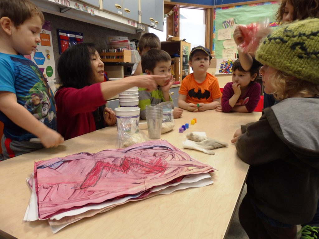 Jeanne Kitayama teaches preschoolers about colors with food coloring and rice. (Emily Files)