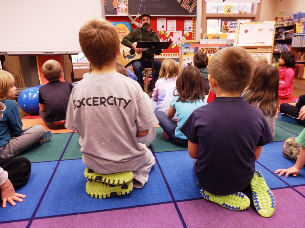 Music teacher Johnathon Baldwin teaches K-2 students in October. Baldwin's position could become full-time due to a boost in state funding. (Emily Files)