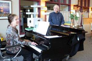 Jacque Farnsworth and Jack Brandt lead a music activity at the Juneau Pioneers' Home. Farnsworth says she's been singing and playing piano there since 2003. (Photo by Lisa Phu/KTOO)