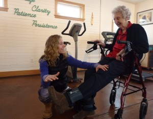 Physical therapist Marnie Hartman works with 92-year-old patient Marge Ward. Hartman says most of her business comes from people 65 and older. (Emily Files)