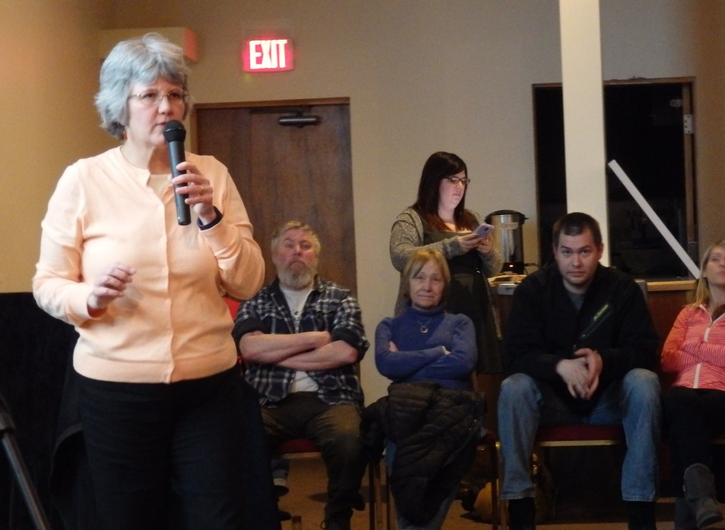 DEC Director of Water Michelle Hale speaks to an audience of more than 80 people in Haines Monday. (Emily Files)