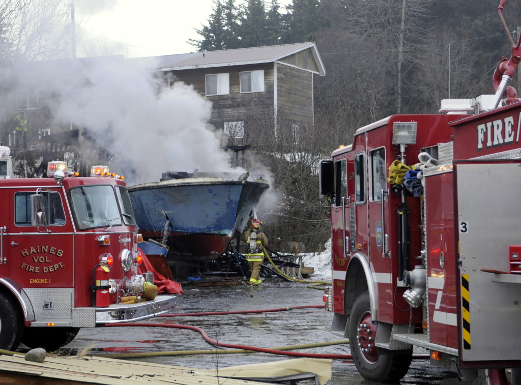 Haines volunteer firefighters extinguish a fire that destroyed a fishing boat on Monday morning. (Jillian Rogers)