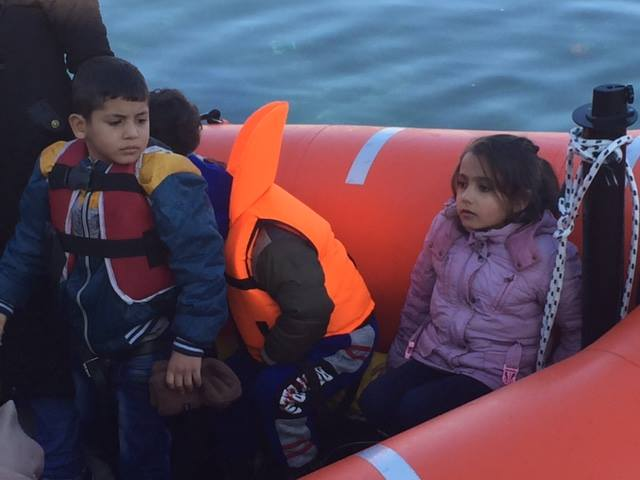Child refugees in a raft that landed in Lesbos in December. (Eric Kocher