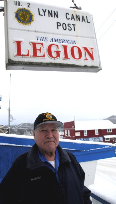 Ralph Strong, a 78-year-old Alaska Native veteran from Klukwan, poses outside the American Legion Hall in nearby Haines. (Photo by Jillian Rogers)