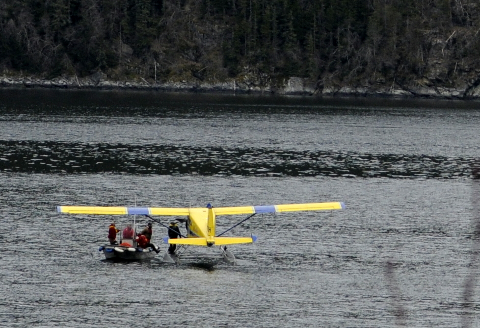 Passenger Richard Hudler of Anchorage is loaded into a boat from the temporarily-disabled float plane. The plane, owned by Alaska Seaplanes, made an emergency landing in Lutak Inlet late Wednesday morning. No injuries were reported. (Jillian Rogers)
