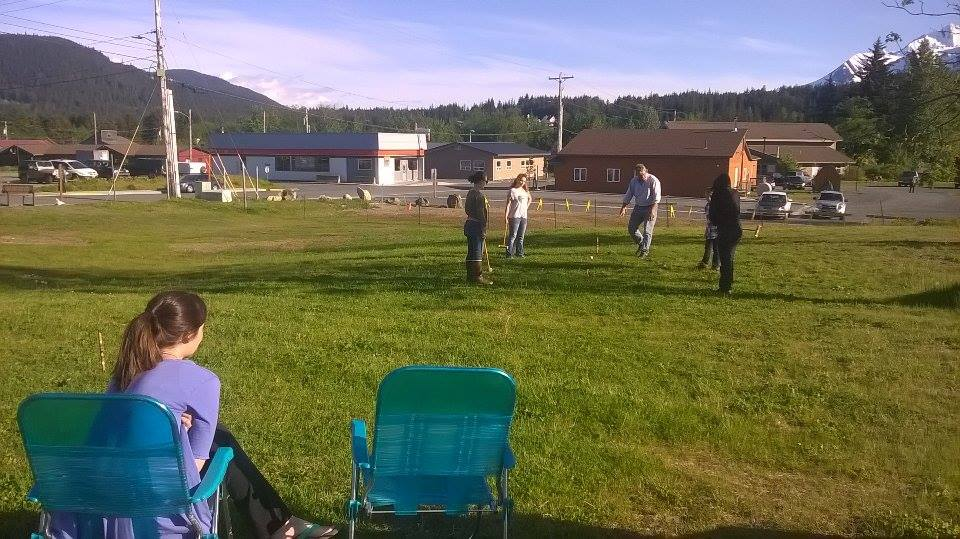 Haines residents play bocce ball on a recent evening at the empty lot on 3rd and Main. It is currently being used    as a sort of unofficial park. (Emily Files)