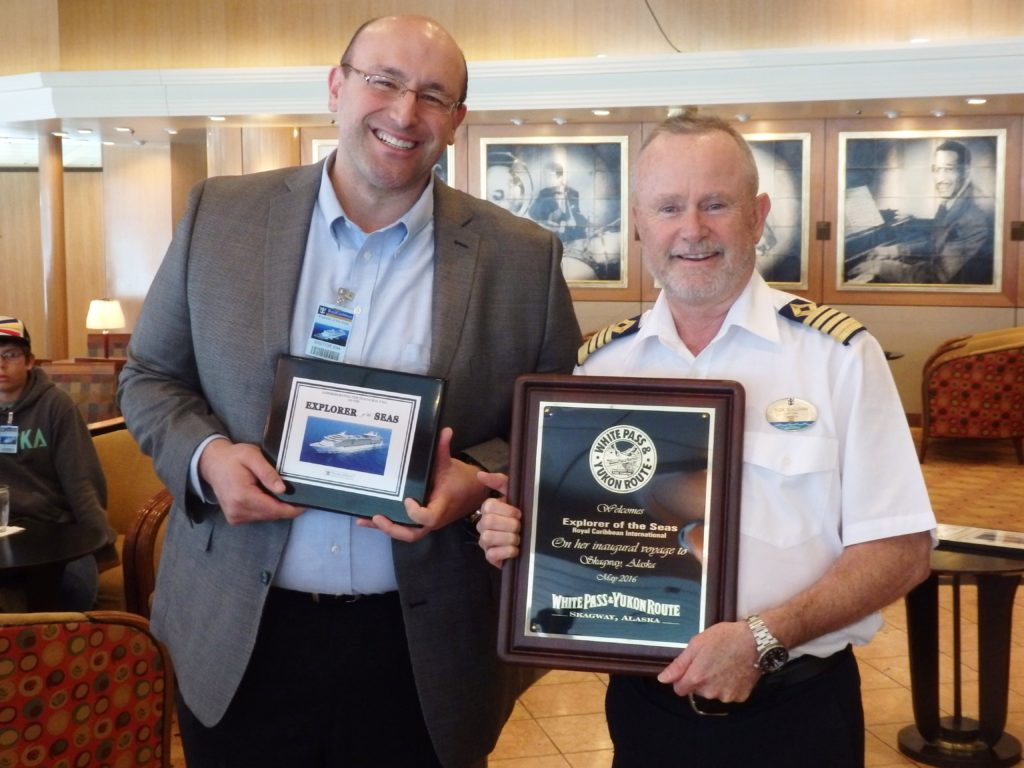 White Pass representative Tyler Rose exchanges plaques with ship captain Rick Sullivan. (Emily Files)