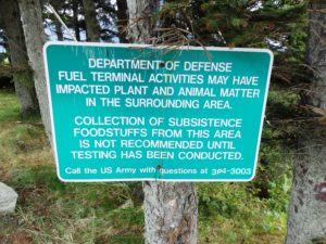 A sign at a beach across from the fuel terminal warns of potential contamination. (Emily Files)