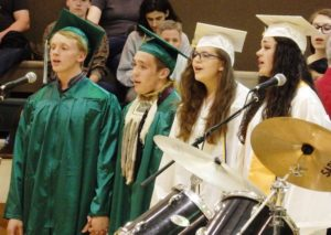 Graduates Matthew Green, Zane Durr, Autumn Gross, and Destinee Cowart sing 'Count on Me.' (Emily Files)