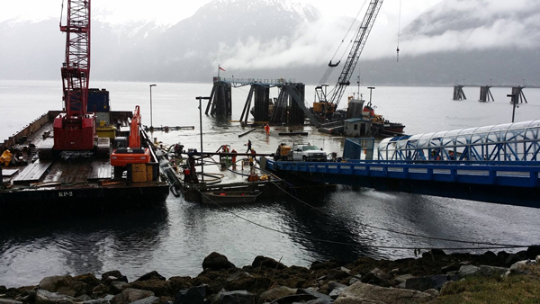 Western Marine Construction works to refloat the Skagway ferr dock in 2014 after it sunk. (Photo courtesy Alaska DOT&PF)